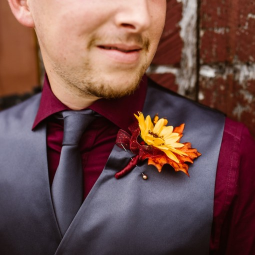 Closeup of groom's sunflower boutonniere at Civil War Ranch