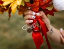 Memorial charms attached to bridal bouquet at Civil War Ranch, Joplin area wedding venue