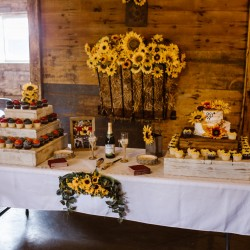 Sunflower themed wedding cake and serving table at Civil War Ranch