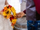 Groom holding Bride's hand at Civil War Ranch, Carthage and Joplin area wedding venue
