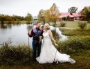Groom and Bride with fishing poles and fish in front of pond