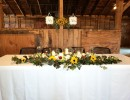 rustic barn reception sunflowers